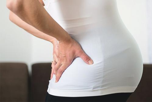 Почему при беременности и после родов болит копчик